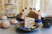 Piece of a cake with tea — Stock Photo