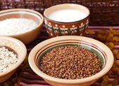 Photo of buckwheat, oat flakes, rice and milk — Stock Photo