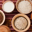 Buckwheat, oat flakes, rice and milk — Stock Photo