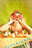 Housewife and cupcakes — Stock Photo