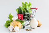 Discount: vegetables in shopping cart — Stock Photo