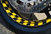 Wheel of motorbike on asphalt — Stock Photo