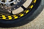 Wheel of motorcycle on asphalt — Stock Photo