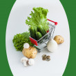 Stock Photo: Vegetables in shopping cart