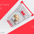 Stock Photo: Coins in shopping cart