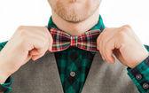 Retro fashion man correcting his bowtie — Stock Photo