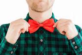 Fashion man correcting his tie — Stockfoto