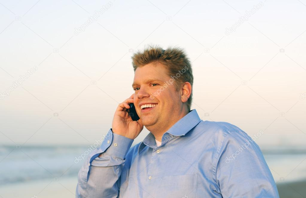 Young smiling businessman on the phone — Stock Photo #12520261