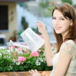 Girl with flowers — Stock Photo #18890363