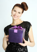Girl with the present — Stock Photo