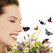 Girl with flowers and butterflies — Stock Photo