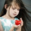 Little girl with a heart — Stock Photo #27929239
