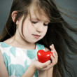 Little girl with a heart — Stock Photo