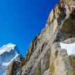 Stock Photo: Climber reaching the summit of mountain