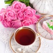 Сup of tea and roses - Stock Photo