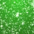 Snowflakes on a green background. A New Year's background. — Vídeo Stock