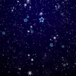 Snowflakes and stars. New Year's - the Christmas background - Stock Photo