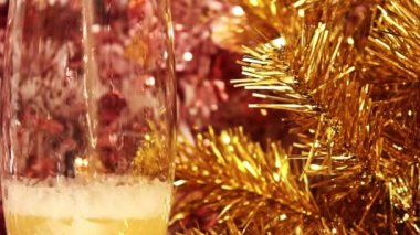 Champagne against a gold fur-tree — Stock Video