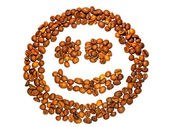 Smile from coffee grains on a white background — Stock Photo