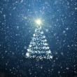 Christmas tree with falling snowflakes and stars — Stock Photo #16759579