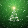 Christmas tree with falling snowflakes and stars — Stock Photo #16759583