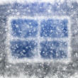 Snow-covered window and falling snowflakes — Stock Photo