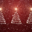 Christmas trees with falling snowflakes and stars — Stock Photo #17692807