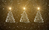 Christmas trees with falling snowflakes and stars — Stock Photo