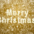 Inscription of Merry Christmas from snowflakes - Stock Photo