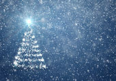 Christmas tree with falling snowflakes and stars — Stockfoto