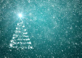 Christmas tree with falling snowflakes and stars — Stock Photo
