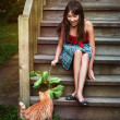 Girl playing with cat — Stock Photo