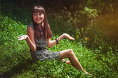 Girl sitting on a grass — Stock Photo