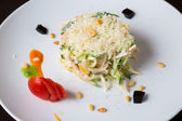 Salad in a white plate — Stock Photo