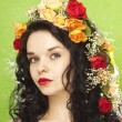 Beautiful girl with flowers in her hair — Stock Photo