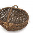 Wicker basket on white — Stock Photo