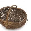Wicker basket on white — Stock Photo
