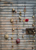 Handmade bells on wooden wall — Stock Photo
