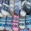 Stock Photo: Knitted mittens with pattern
