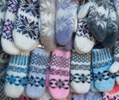 Knitted mittens with pattern — Stock Photo