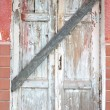 Old wooden doors boarded up — Stock Photo