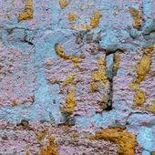 Wall of limestone blocks in plaster — Stock Photo