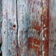 Part of old wooden door in poor condition with peeling paint — Stock Photo