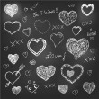 Set of hand drawn hearts on chalkboard background — Stock Vector