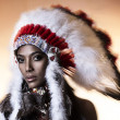American Indian woman model girl studio portrait wearing war bonnet — Stock Photo #13892818