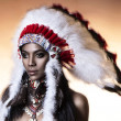 American Indian woman model girl studio portrait wearing war bonnet — Stock Photo #13892870