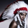 Stock Photo: AmericIndiwommodel girl studio portrait wearing war bonnet