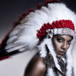 American Indian woman model girl studio portrait wearing war bonnet - Stock Photo