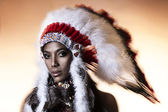 American Indian woman model girl studio portrait wearing war bonnet — Stock Photo