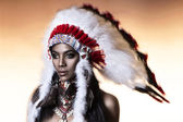 American Indian woman model girl studio portrait wearing war bonnet — Foto Stock